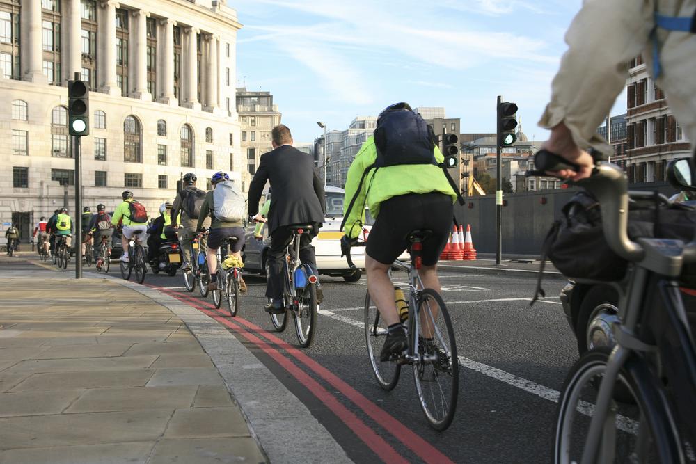 People riding their bikes to work
