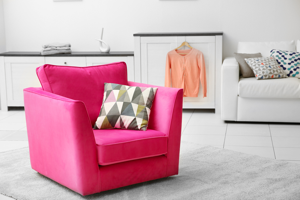 Bright pink chair in living room
