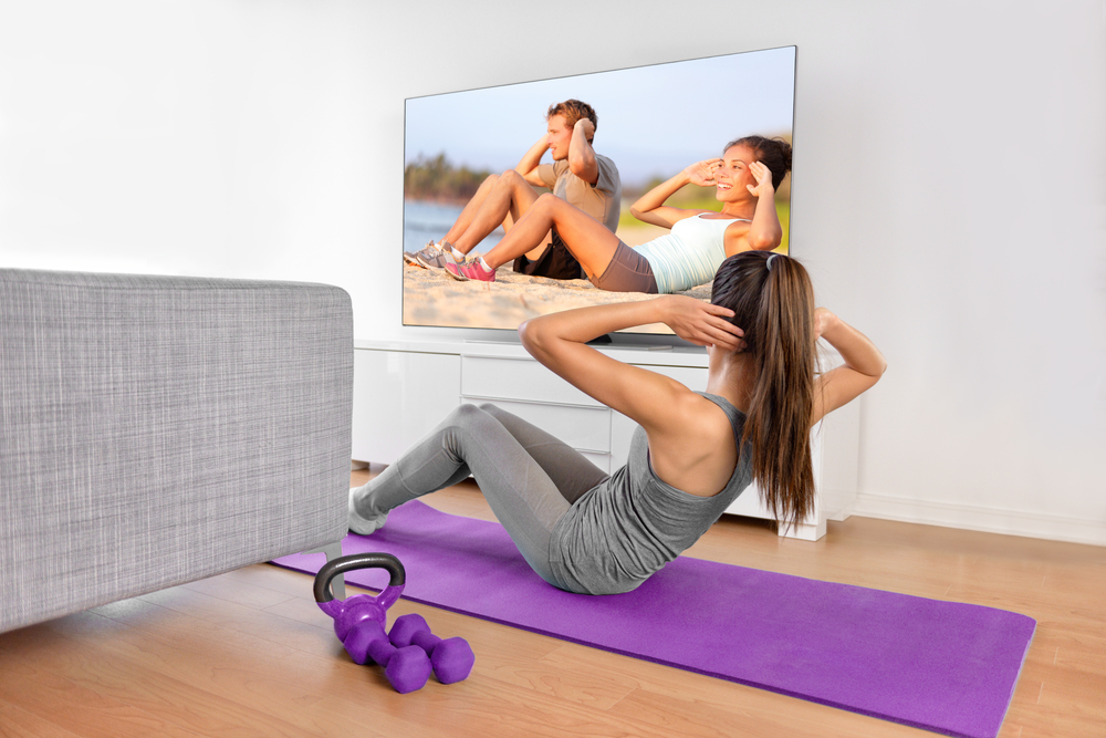 Woman exercising to free video